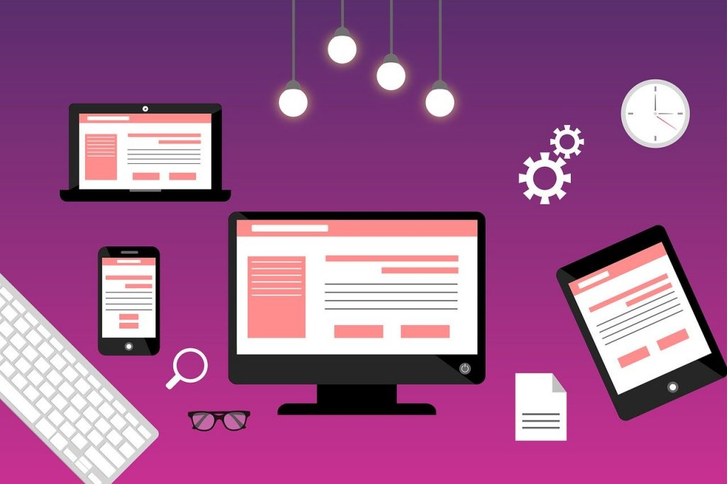 website design on computer, laptop, phone, and tablet